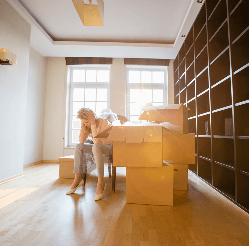 Things to NOT Do When Moving Into Your New Home Woman Cardboard Boxes Image